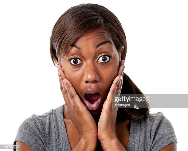 Shocked young woman covers her cheeks with her hands
