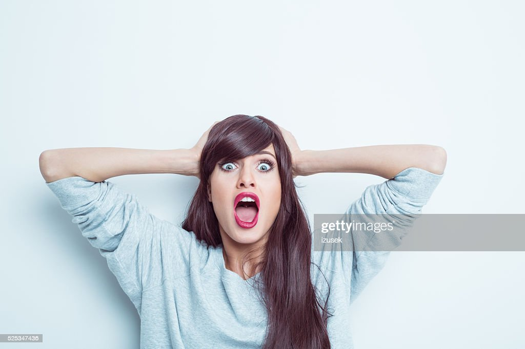 Shocked young woman : Stock Photo