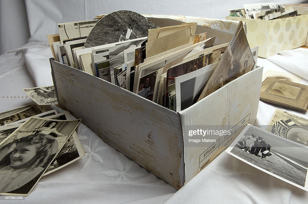 Shoe box of old family photographs : Stock Photo