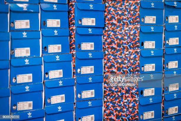 Shoe boxes containing trainers with a public transport ticket are seen as people queue up to buy the Adidas / BVG trainers at the Overkill shoe store...