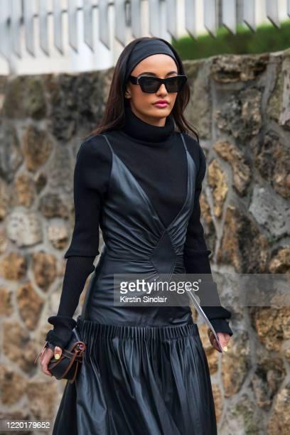 Shoe designer and digital influencer Amina Muaddi wears all Loewe on February 28 2020 in Paris France