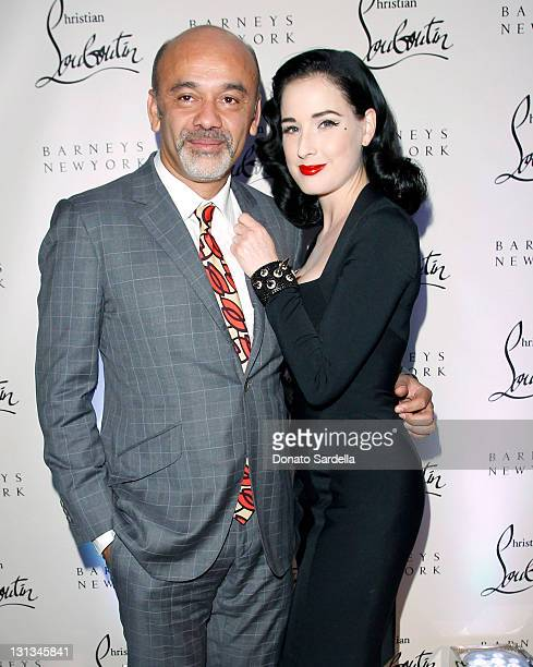 Shoe designer Christian Louboutin and Dita Von Teese attend the Christian Louboutin 20th Anniversary and Book Launch at Barneys New York on November...