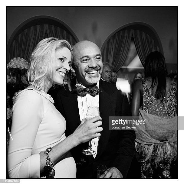 Shoe designer Christian Louboutin is photographed with a friend at Vanity Fair Cannes Party at the Eden Roc Cap d'Antibes for Vanity Fair Magazine on...