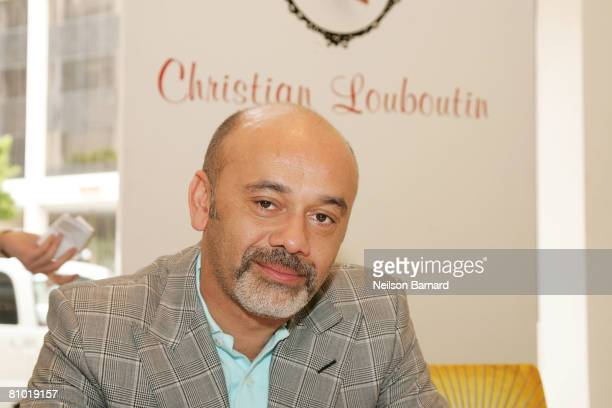 Shoe designer Christian Louboutin poses for a photograph at the launch of his new fall collection at Barneys New York on May 7 2008 in Beverly Hills...