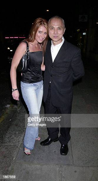 Shoe Designer Jimmy Choo and an unidentified friend arrive at the Sketch Nightclub March 22 2003 in London
