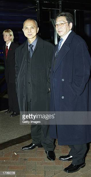 Shoe designer Jimmy Choo and unidentified friend attend the premier of the new film 'About Schmidt' starring Jack Nicholson at the Warner Bros...