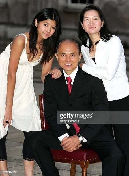 Shoe designer Jimmy Choo poses with his wife Rebecca Choo and daughter Emily Choo after he received the Freedom of the City of London award November...