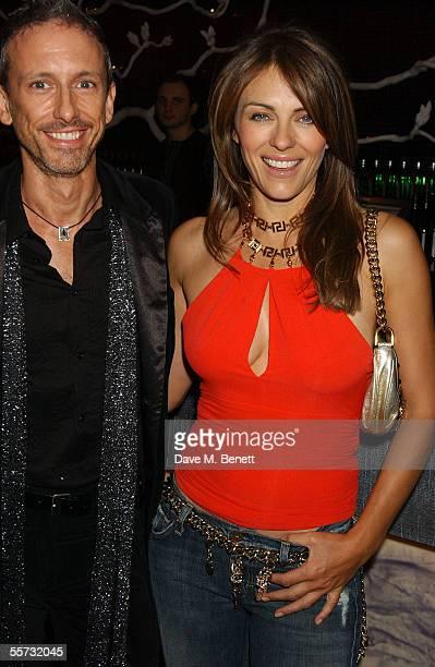 Shoe designer Patrick Cox and model/actress Elizabeth Hurley attend the 20th Anniversary Party for Cox at Nobu, Berkeley Street on September 20, 2005...