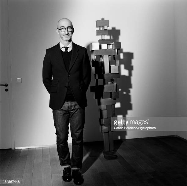 "Shoe designer Pierre Hardy is photographed with his muse the sculpture ""Tower"" d'Antony Gormley for Madame Figaro on October 21, 2011 in Paris,..."
