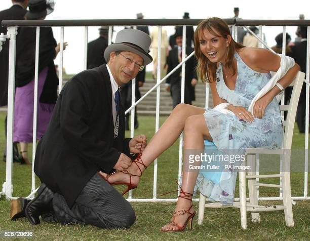 Shoe designer Stuart Weitzman doing up his 1 million creation on Laura Rumble for the ladies day meeting at Royal Ascot.