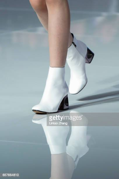 Shoe detail as a model showcases designs on the runway at 'Hempel Award' the 25th China International Young Fashion Designers Contest during the...