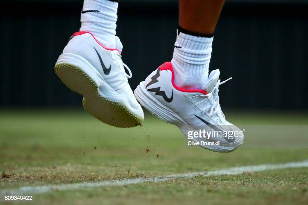 Shoe detail of Rafael Nadal of Spain as he serves during the Gentlemen's Singles second round match against Donald Young of The United States on day...