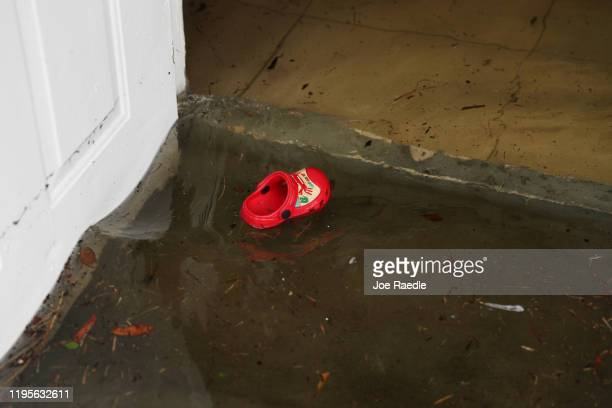 Shoe floats out of a home that was inundated with flood water on December 23, 2019 in Hallandale, Florida. The area received up to 12 inches of rain...