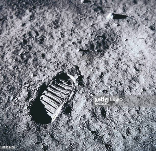 shoe imprint on the surface of the moon