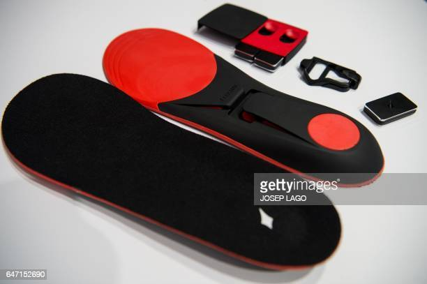Shoe insoles 'Lechal' by Ducere's technologies Pvt Ltd company are on display during the Mobile World Congress on the last day of the MWC in...