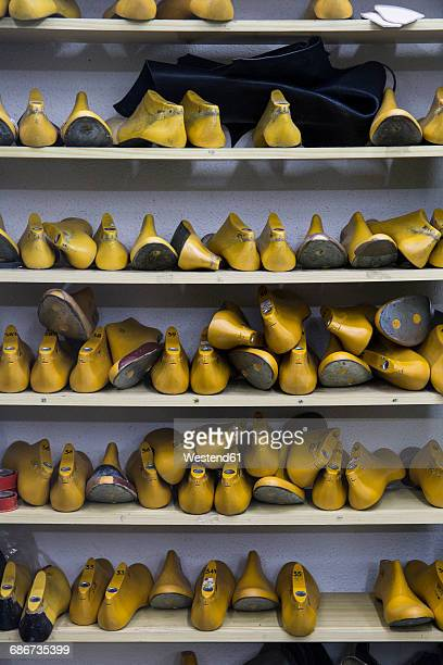 shoe lasts on shelf in shoemaker workshop - shoe factory stock pictures, royalty-free photos & images