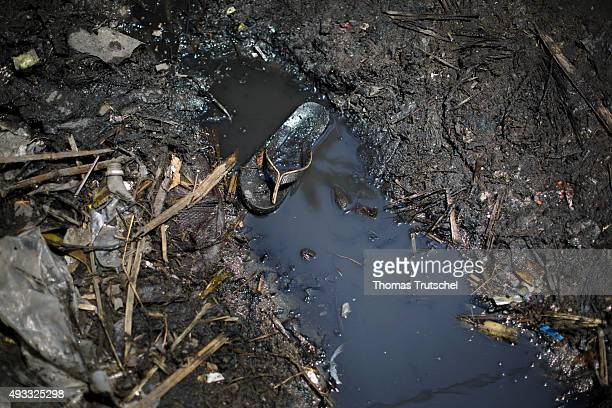 A shoe lies in a drainage ditch in a slum in the city of Beira on September 28 2015 in Beira Mozambik