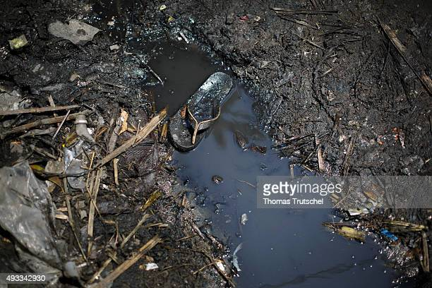 A shoe lies in a drainage ditch in a slum in the city of Beira on September 28 2015 in Beira Mozambique