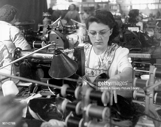 Shoe manufacture 1950 Miss Renee Rose using a Singer sewing machine for fancy stitching on shoes at Messrs Roberts factory in Leicester Scene from...