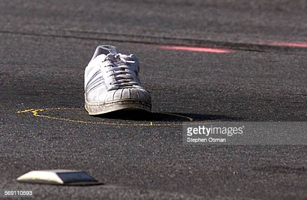 A shoe of a victim killed after being struck by an Oxnard Police cruiser sits in the center of Ventura Road An Oxnard Police cruiser enroute to a...