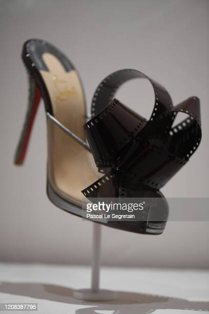 A shoe of the Christian Louboutin's Exhibition L'Exhibitioniste is on display At Palais De La Porte Doree In Paris on February 24 2020 in Paris France