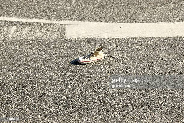 Shoe on asphalt
