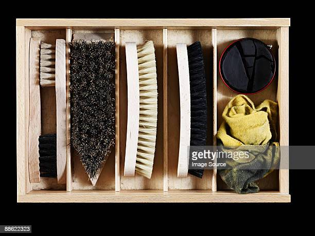 Shoe polish and brushes in a box