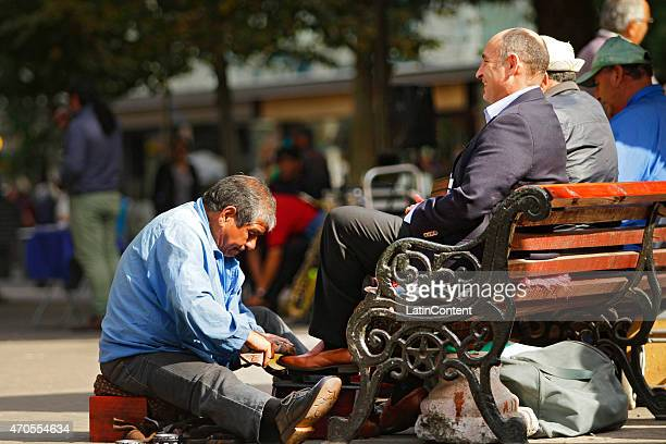 A shoe polisher works at Concepcion downtown on April 15th 2015 in Concepcion Chile Concepcion is one of the eight host cities of the next Copa...