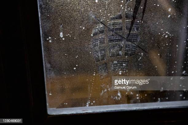 Shoe print is seen on the northern entrance to the U.S. Capitol building in the remnants of pepper spray, tear gas, and fire extinguishers on January...