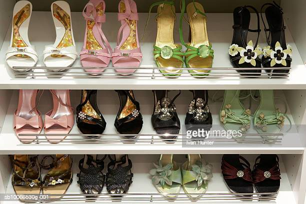 shoe rack with elegant woman sandals - walk in closet stock photos and pictures