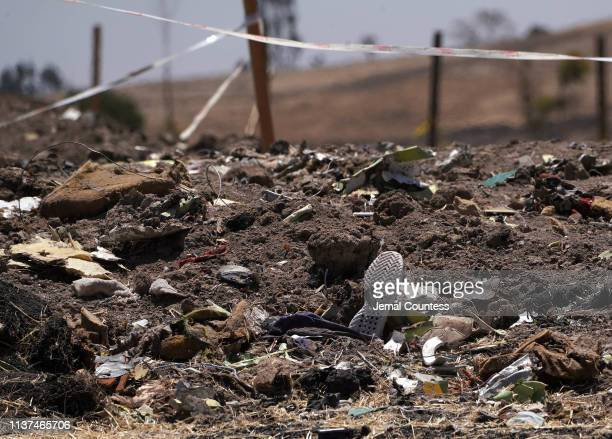 A shoe rests amidst other debris just outside the crater where Ethiopian Airlines flight ET302 crashed on March 10 2019 The Asrahhullet or Tulluferra...