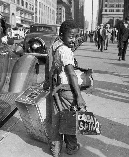 Black Shoe Shine Boy On City Street