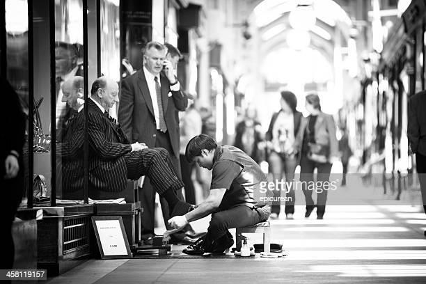 Shoe shiner in the Burlinton Arcade