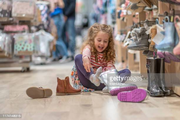 shoe shopping - shopping centre stock pictures, royalty-free photos & images