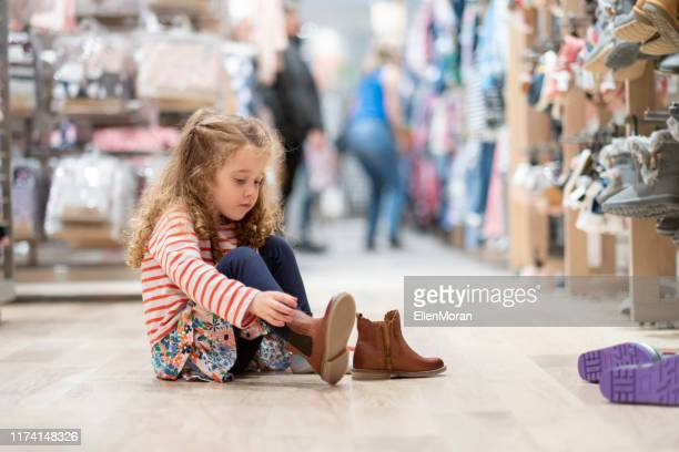 shoe shopping - footwear stock pictures, royalty-free photos & images