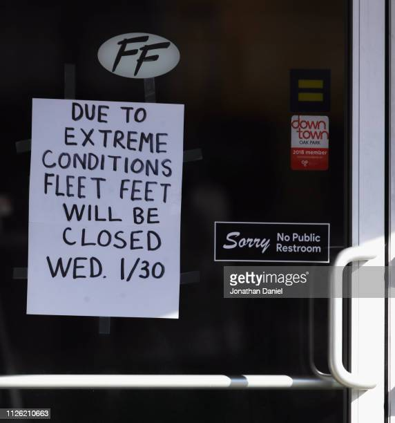 A shoe sore displays a sign that it is closed due to weather on January 30 2019 in Oak Park Illinois