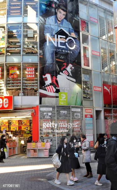 A shoe store in Tokyo's trendy Shibuya district advertises its Adidas Neo shoes and the brand's celebrity spokesman American singer Justin Bieber