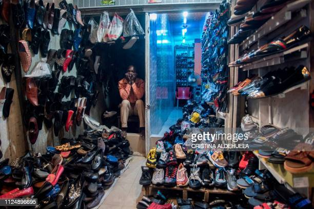 TOPSHOT A shoe vendor sits in his shop in the Ariaria International Market famous for shoe making and leather work in Aba a city in one of the...