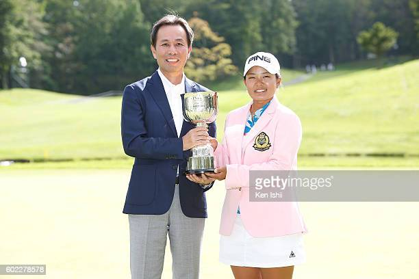 Shoei Yamana President and CEO of Konica Minolta and Ai Suzuki of Japan pose with her trophy on the 18th hole after winning the 49th LPGA...