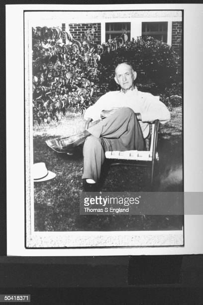 Shoeless Joe Jackson controversial baseball player in later life as successful liquor store owner seated on lawn chair by house