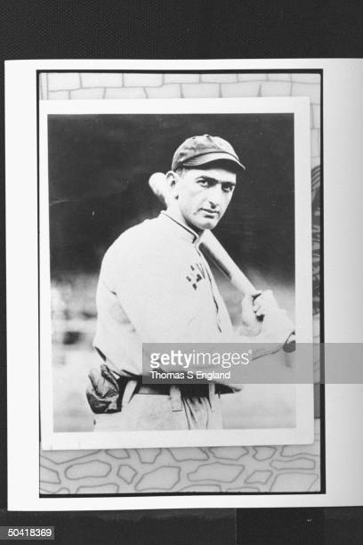 Shoeless Joe Jackson controversial baseball player in tight shot holding bat during game LOCATION UNKNOWN
