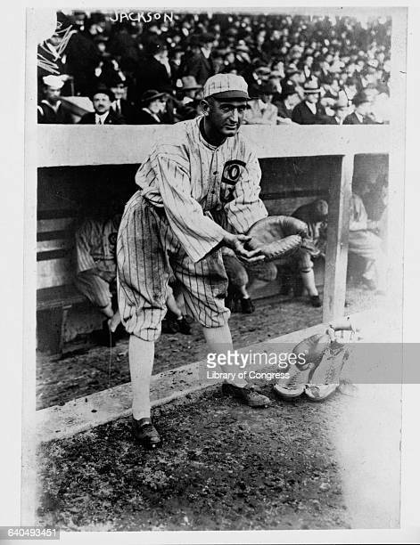 Shoeless Joe Jackson holds out his glove in front of the White Sox dugout
