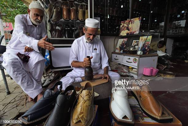 Shoemaker Cha cha NoorudDin makes shoes for Pakistan's cricketerturned politician Imran Khan and head of the Pakistan TehreekeInsaf party at a store...