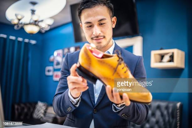 shoemaker checking a leather shoe - calzature di pelle foto e immagini stock
