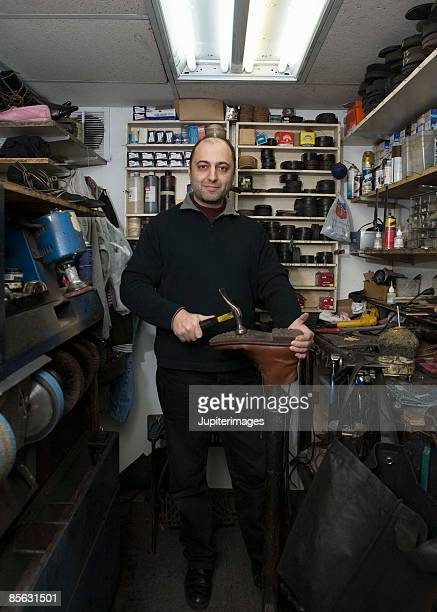 Shoemaker in workshop