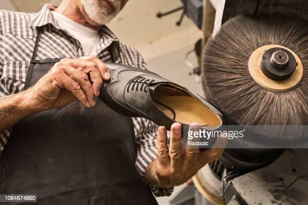shoemaker polishing shoes on polishing machine - suede shoe stock pictures, royalty-free photos & images