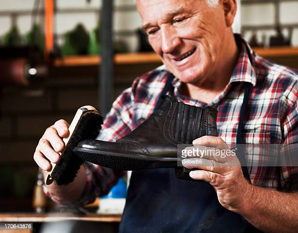 Shoemaker polishing shoes