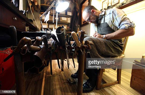 A shoemaker works in the Carreducker shoe workshop within the Gieves Hawkes store owned by Trinity Ltd on Savile Row in London UK on Tuesday Aug 7...
