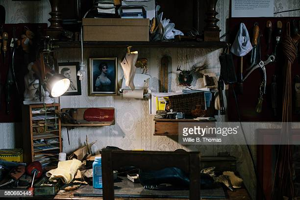 shoemaker's workshop - angle poise lamp stock pictures, royalty-free photos & images