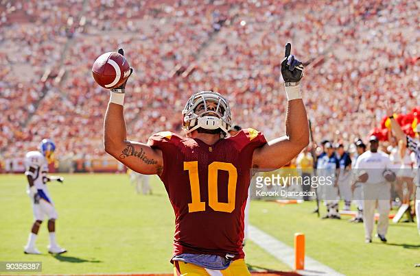 Shoemate of the USC Trojans celebrates after scoring a touchdown against the San Jose State Spartans during the fourth quarter at Los Angeles...